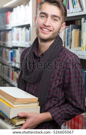Smiling student in the library at the university