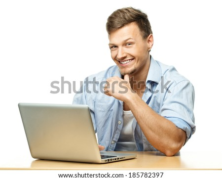 Smiling stylish young man behind laptop isolated on white
