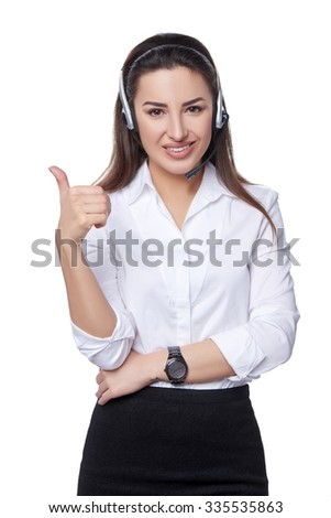 Smiling support phone operator in headset gesturing thumb up, isolated on white