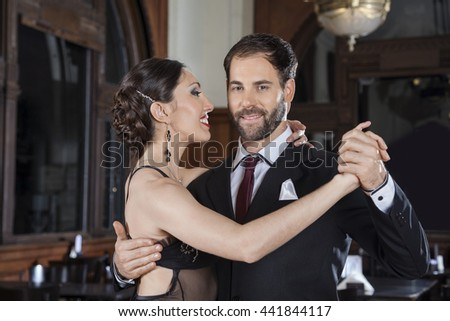Smiling Tango Dancer Performing Gentle Embrace With Partner