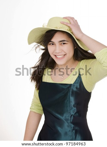 Smiling teen  biracial girl in green dress and lime green hat