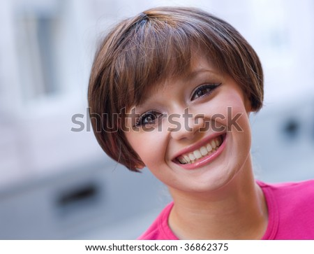 smiling teen girl on the street