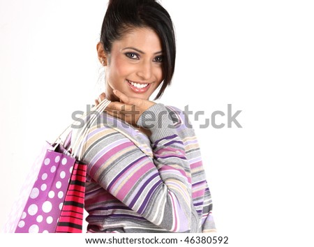 smiling teenage girl with shopping bags