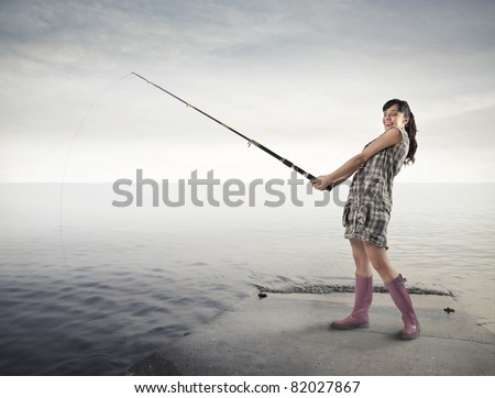 Smiling woman fishing