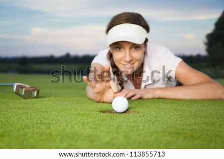 Smiling Woman Golf Player Putting Successfully Stock Photo