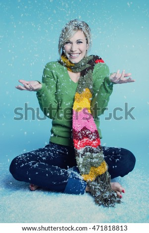 Smiling woman playing in snow
