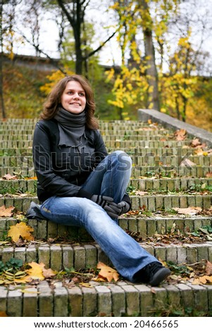smiling woman sit on the stairs
