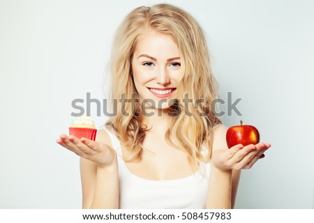 Smiling Woman with Healthy and Unhealthy Food. Difficult choice. Overweight Concept