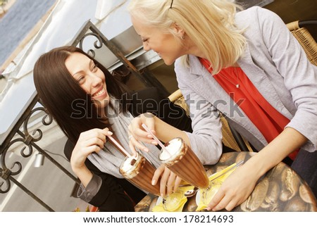 smiling women drinking a coffee