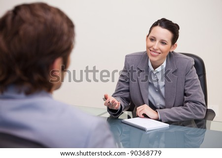 Smiling young businesswoman in a negotiation