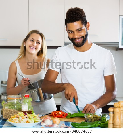 Beautiful black husband helping white wife stock photo for Xnxx in the kitchen