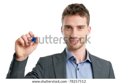 Smiling young man writing with marker isolated on white background