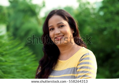 Smiling young woman at outdoors
