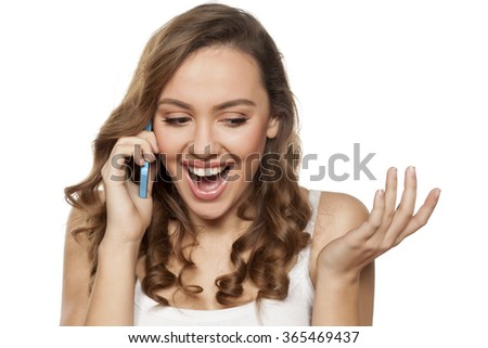 smiling young woman talking on the phone