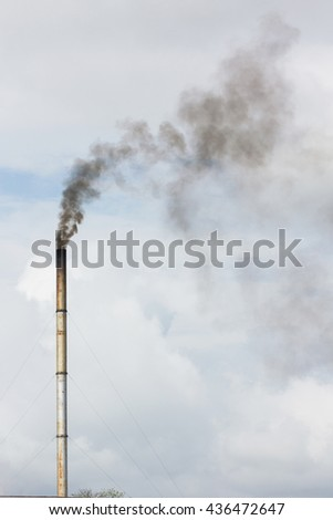 smoke from chimney of rice mill in thailand