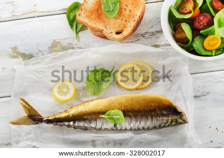 Smoked mackerel  with  toast and fresh salad. Top view
