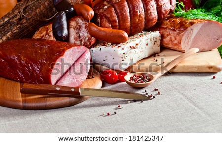 smoked meat and sausages on a linen cloth
