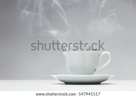 smoking hot cup of tea shot in the studio