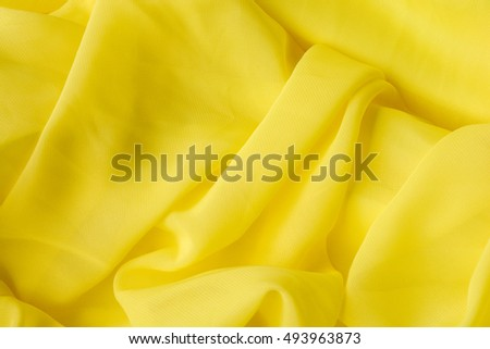 Smooth elegant golden silk, Yellow fabric texture background.