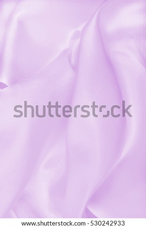 Smooth elegant lilac silk or satin texture can use as wedding background. Luxurious valentine day background design