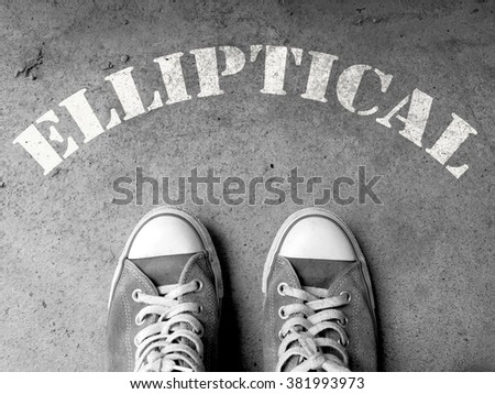 Sneakers on concrete floor background with text : a