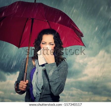 Sneezing Woman with Umbrella over Autumn Rain Background. Sick Woman ...