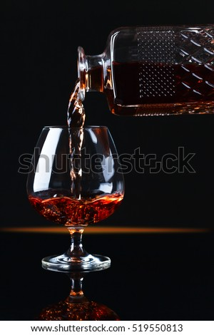 Snifter with brandy on a black background