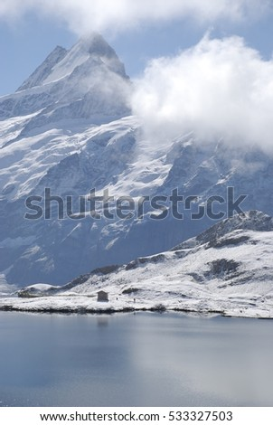 Snow and lakes in Swiss Alps in August, Faulhorn, Interlaken, Switzerland