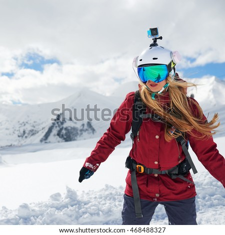 Snowboarder girl in a red jacket