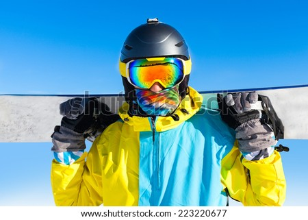 Snowboarder hold snowboard on top of hill close up portrait, snow mountains snowboarding on slopes