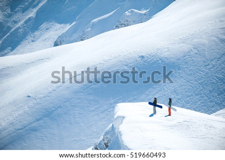 snowboarders on the background of snowy Carpathian mountains in Europe