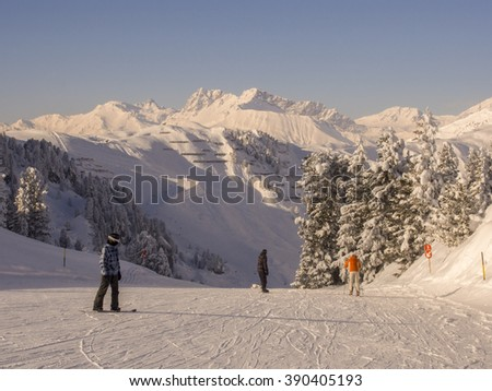 Snowboarding on the mountain tops in Austria.
