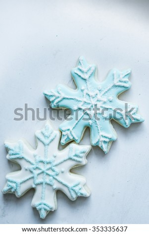 Snowflake cookies on white pastel background