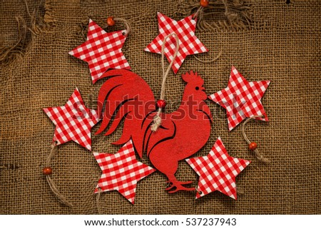 snowflake shape and chicken decoration made wood tree on canvas background. Symbol red fire rooster of year 2017
