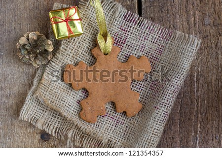 Snowflake shape gingerbread cookie with cone and present