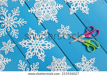 Snowflakes cut from paper.  A traditional Christmas arts and crafts project.