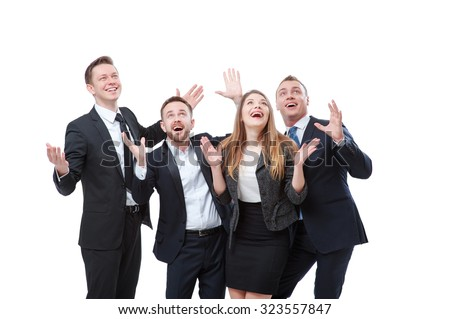 So wonderful! Group of exciting businesspeople looking up and gesturing while expressing positivity. Isolated on white.