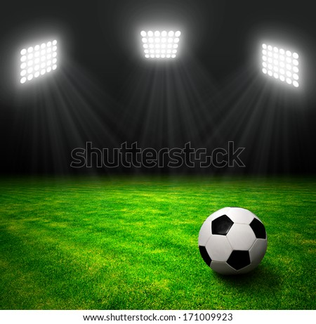 Soccer ball in grass, soccer stadium with the dright lights. - stock ...