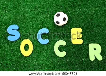 Soccer ball on atificial turf - word plastic colours