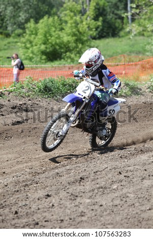 "SOCHACZEW, POLAND - JUNE 10: Unknown racer on the women championship of motocross ""Polish Championship - fourth round"" on June 10, 2012 in Sochaczew, Poland"