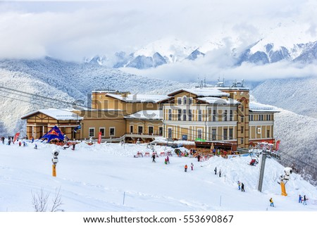 Sochi, Russia - January 9, 2015: Beautiful modern and elegant Solis Sochi Hotel is located on a snowy mountain slope and fronts onto snowy and scenic Caucasus Mountains peaks winter landscape