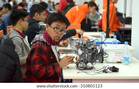 SOCHI, RUSSIA - November 21, 2014: Taiwan children make a robot at the robot Olympiad in Sochi. Here there was the World Robotic Olympiad 2014. It was attended by delegates from 47 countries.