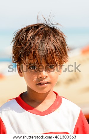 SOCOTRA, YEMEN - JAN 12, 2014: Unidentified Yemeni little boy portrait on the beach of the Island of Socotra. Children in Socotra live in poverty and grow without education