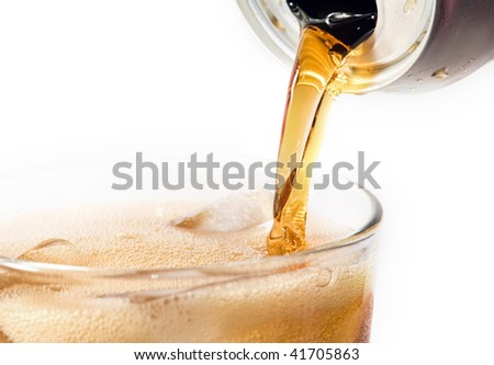 Soda pouring into a Glass against a white background
