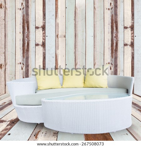 sofa furniture weave bamboo stick chair with yellow pillows on wooden wall