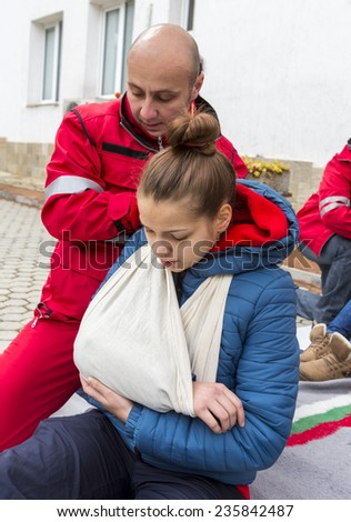 Sofia, Bulgaria - December 5, 2014: Members from Bulgarian Red Cross Youth (BRCY) voluntary youth organization are participating in a training simulation of a natural disaster situation.