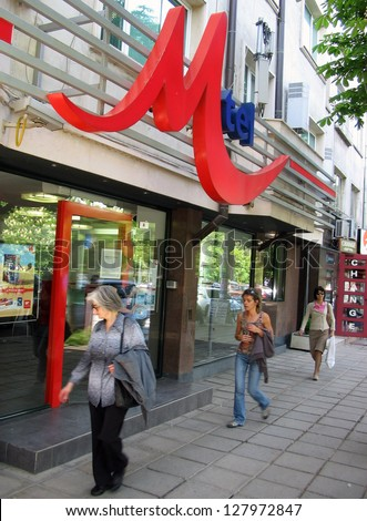 SOFIA - MAY 20: Shoppers pass a M-Tel mobile telephone company retail shop in Sofia, Bulgaria, on Friday, May 20, 2006.