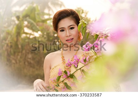 Soft Beautiful Thai women wearing typical Thai dress, identity culture of Thailand