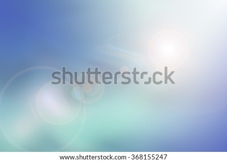 Soft colored abstract background in darker shades of green, blue and yellow.