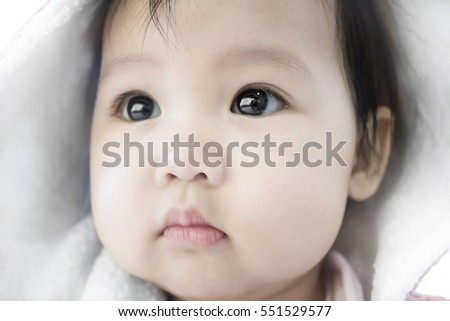 soft focus of cute asian baby with hood during winter